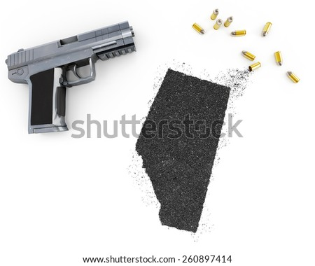 Gunpowder forming the shape of Alberta and a handgun.(series) - stock photo
