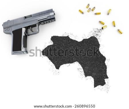 Gunpowder forming the shape of Guinea and a handgun.(series) - stock photo