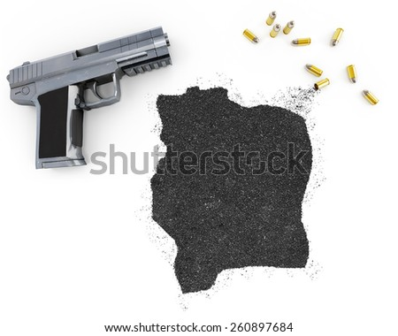 Gunpowder forming the shape of Ivory Coast and a handgun.(series) - stock photo