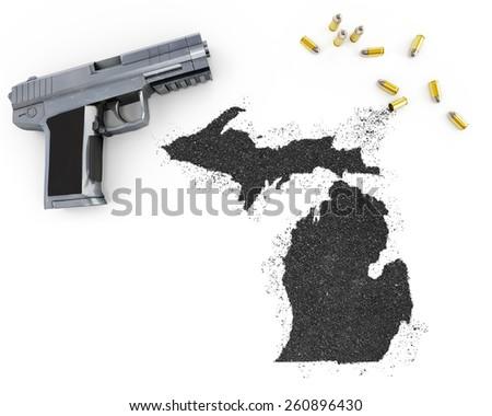Gunpowder forming the shape of Michigan and a handgun.(series) - stock photo