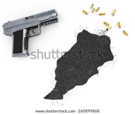 Gunpowder forming the shape of Morocco and a handgun.(series) - stock photo