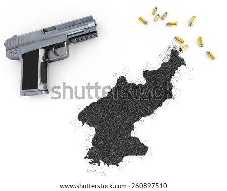 Gunpowder forming the shape of North Korea and a handgun.(series) - stock photo