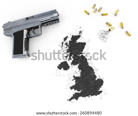 Gunpowder forming the shape of United Kingdom and a handgun.(series) - stock photo