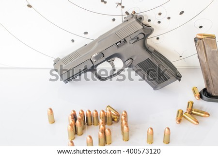 Guns , ammunition,and  target ammunition on white background. - stock photo