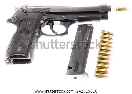 Guns and ammunition,ammo,bullets on white background - stock photo