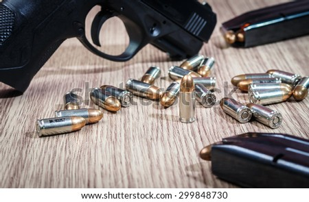 Guns and ammunition on wooden. - stock photo