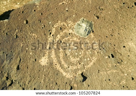 Gunshot wound to Native American petroglyph at Petroglyph National Monument, outside Albuquerque, New Mexico - stock photo