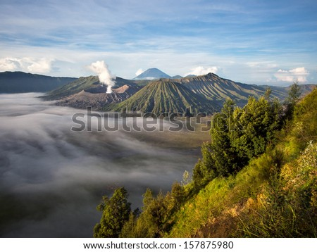 Gunung Bromo, Mount Batok and Gunung Semeru seen from Mount Penanjakan in Java, Indonesia. - stock photo