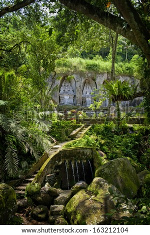 Gunung Kawi, Bali, Indonesia. Gunung Kawi is an 11th-century Hindu temple complex in Tampaksiring north east of Ubud in Bali.. . The complex comprises 10 rock-cut  shrines carved into the cliff face. - stock photo