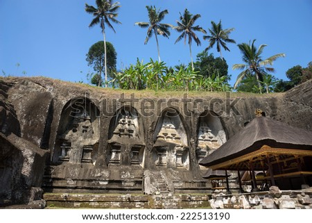 Gunung Kawi is a temple complex in Bali Island centered around royal tombs carved into stone cliffs dating back to the 11th century. - stock photo