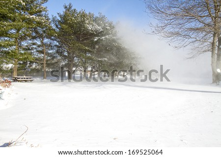 Gust of wind twirling snow after snow storm (One) - stock photo