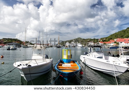 Gustavia, st.Barts-November 25, 2015: Different yacht docked on water in bay sunny day with clouds on sky outdoor