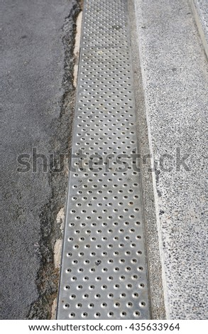 Gutters drain grate, drain cover - stock photo