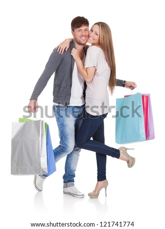 Guy and gal brings shopping bags in variety of colors.