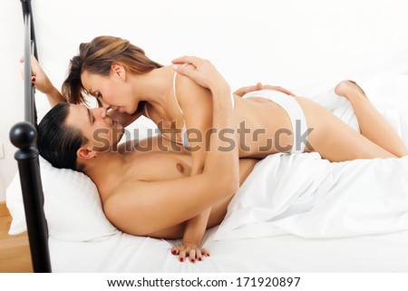 guy and girl having sex on white sheet in bed