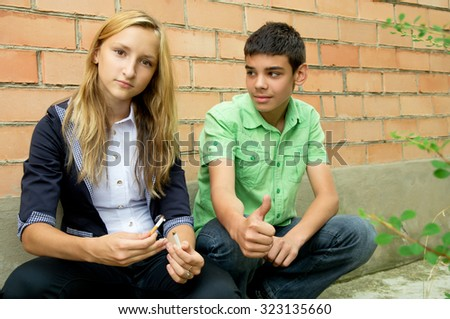 Guy and the girl broke her cigarette - stock photo