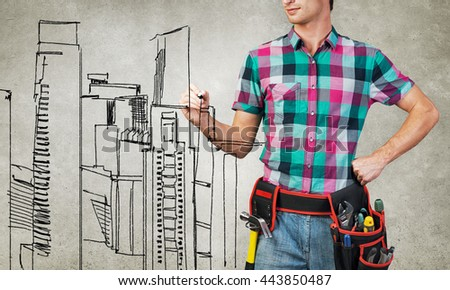Guy engineer sketching his ideas