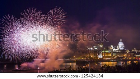 Guy Fawkes night fireworks on Thames River and St Paul's Cathedral in London at night, London, United Kingdom - stock photo