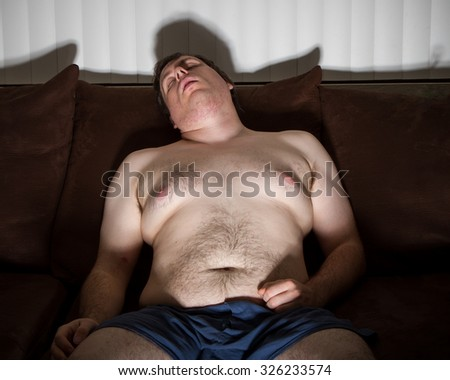 guy fell asleep watching the TV - stock photo