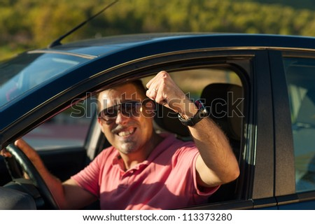Guy getting aggresive in a road rage attitude - stock photo