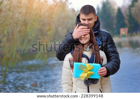 guy gives the girl a gift. - stock photo