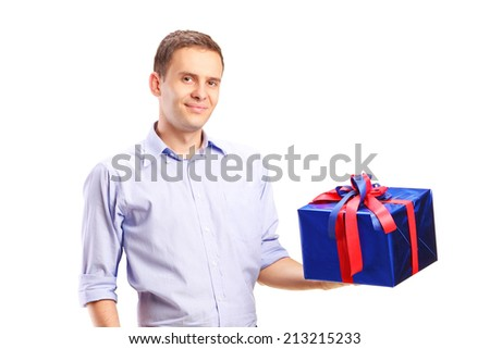 Guy holding a big present isolated on white background