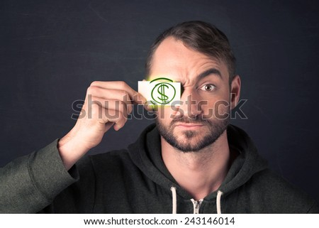 Guy holding a paper with hand drawn green dollar sign - stock photo