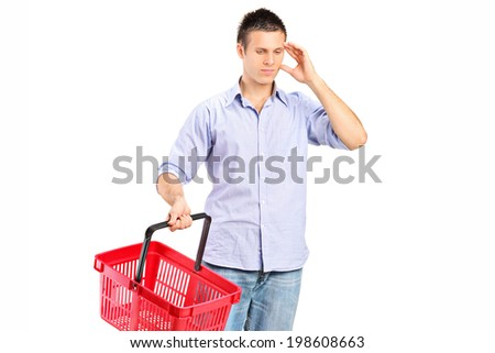 Guy holding an empty shopping basket isolated against white background