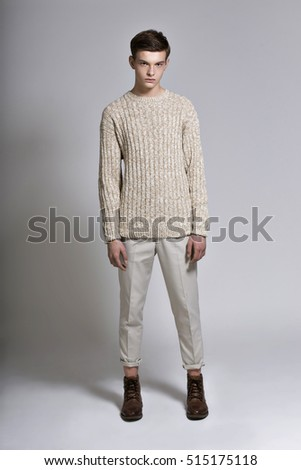 Guy in a bright sweater posing in the Studio
