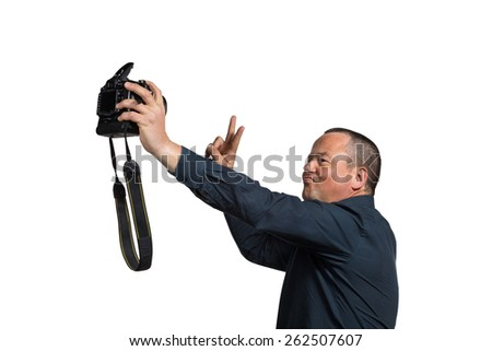 Guy in his 40s fooling around with too big a camera for a selfie