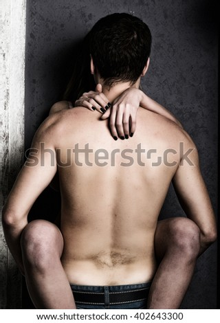 guy in jeansn holds woman's legs. Sweet moments of intimacy. sexual relationships between lovers - stock photo