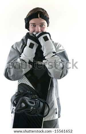 Guy in snowboarding gear with board, isolated - stock photo