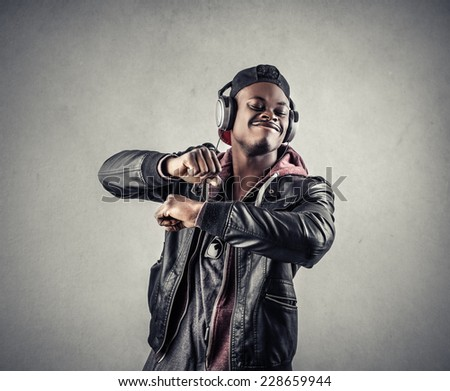 Guy listening to music and dancing  - stock photo