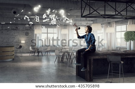 Guy making announcement - stock photo