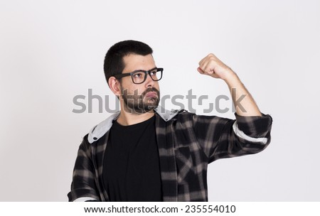 Guy making power gesture wearing black glasses - stock photo