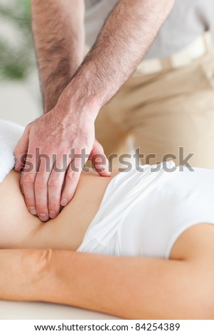Guy massaging a person's back in a room - stock photo