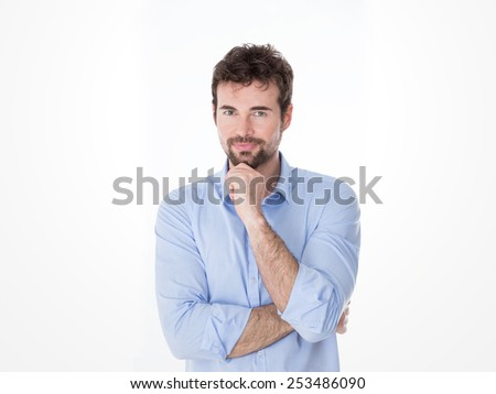guy on casual clothes with fist on his goatee - stock photo
