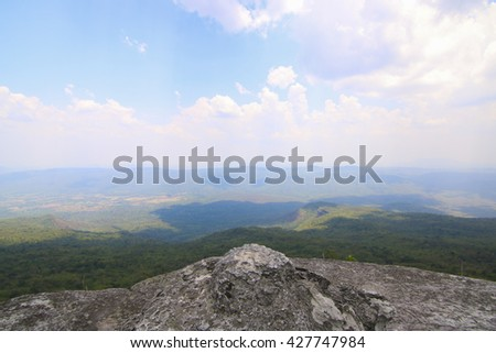 Guy on the top of a boulder - stock photo