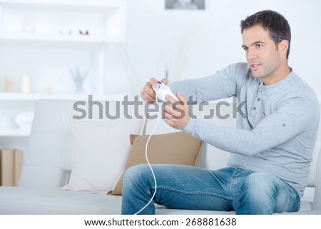 Guy playing a video game - stock photo