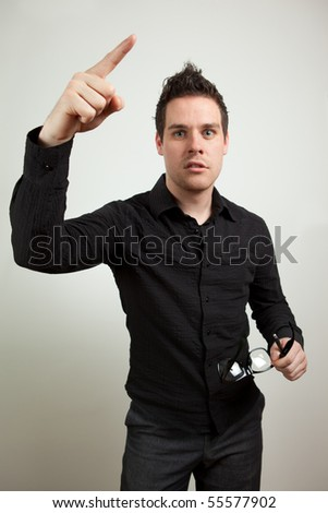 Guy pointing up with his index finger - stock photo