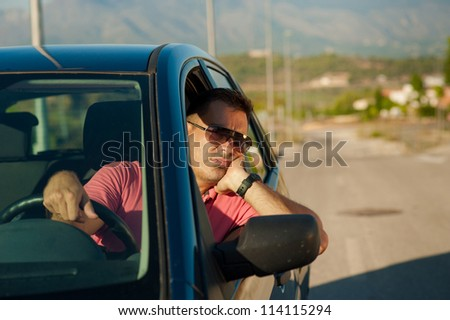 Guy pretty bored while waiting for an open road - stock photo
