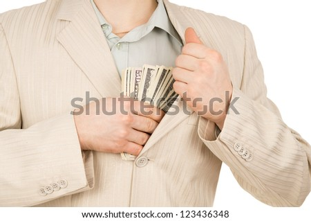 guy puts the money in his pocket isolated on white background - stock photo