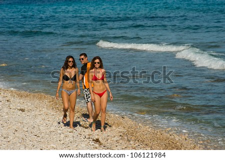 Guy really liking what  he is seeing on the beach - stock photo