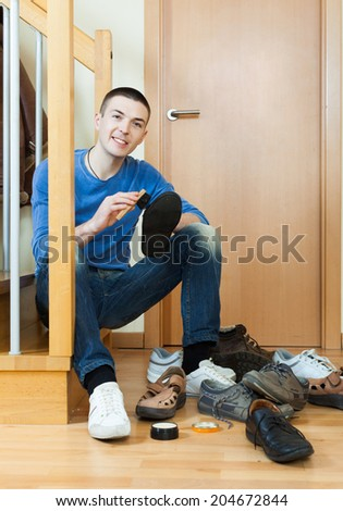 guy sitting on stairs and cleaning footwear