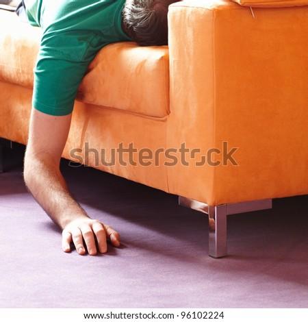 guy sleeping on the sofa - stock photo