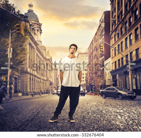Guy standing in the street - stock photo