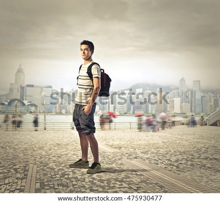 Guy visiting a big city