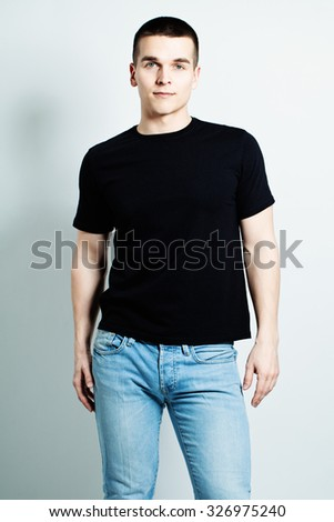 Guy Wearing Black T-Shirt and Blue Jeans - stock photo