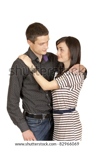 guy with a girl standing in the arms isolated on a white background