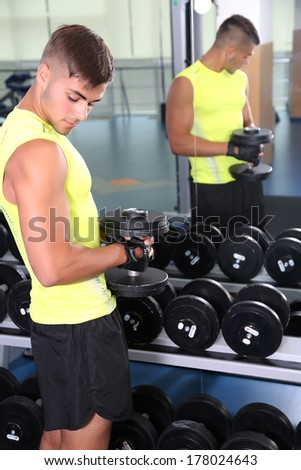 Guy with dumbbells in gym